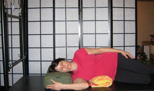 The towel helps decrease any side bending through the lumbar spine